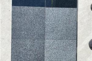 柬埔寨黑火烧面柬埔寨G654荔枝面光面板材可代替福鼎黑花岗岩